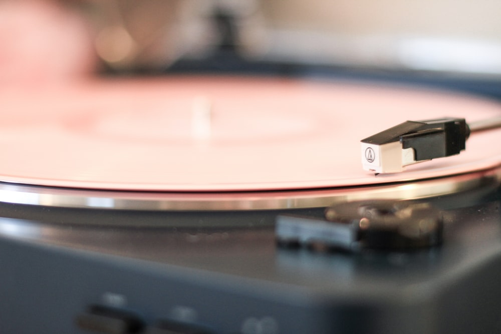 selective focus photography of black turntable