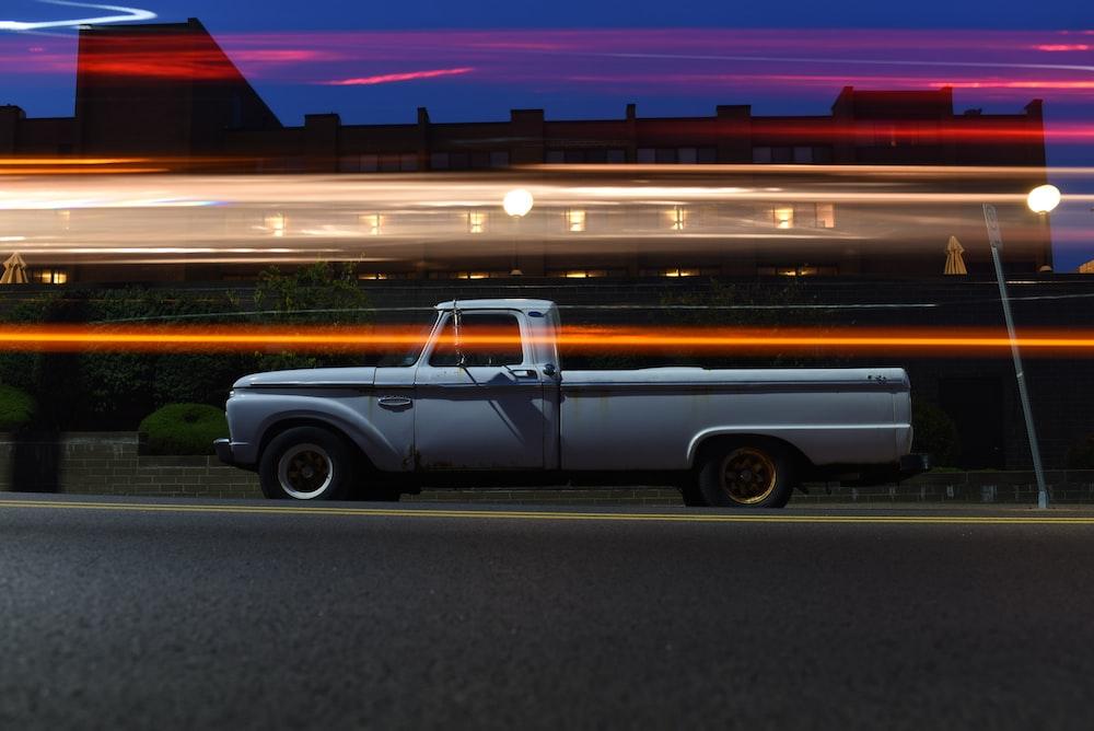 timelapse photo of white single cab truck