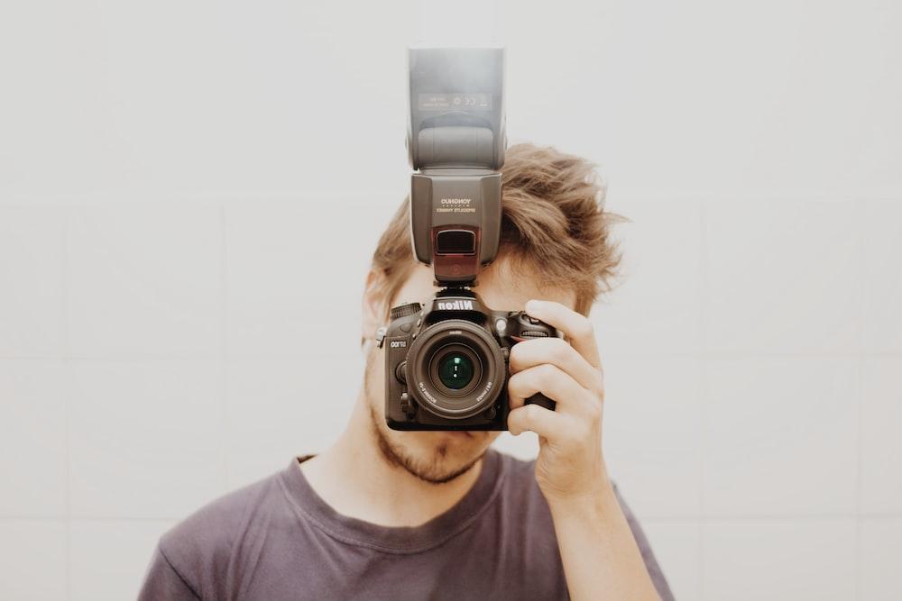 man taking a mirror shot photo