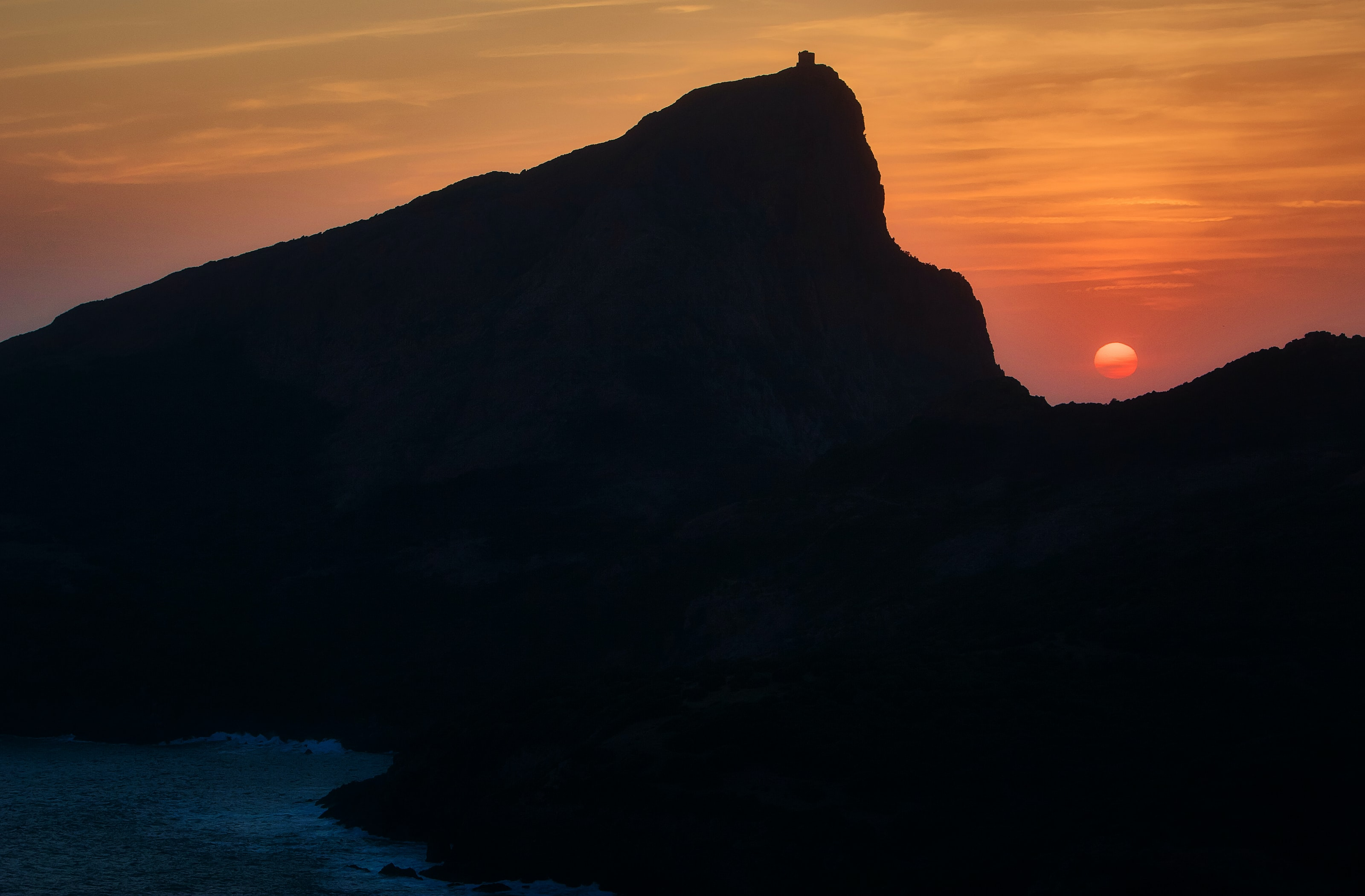 silhouette of mountain at sunset