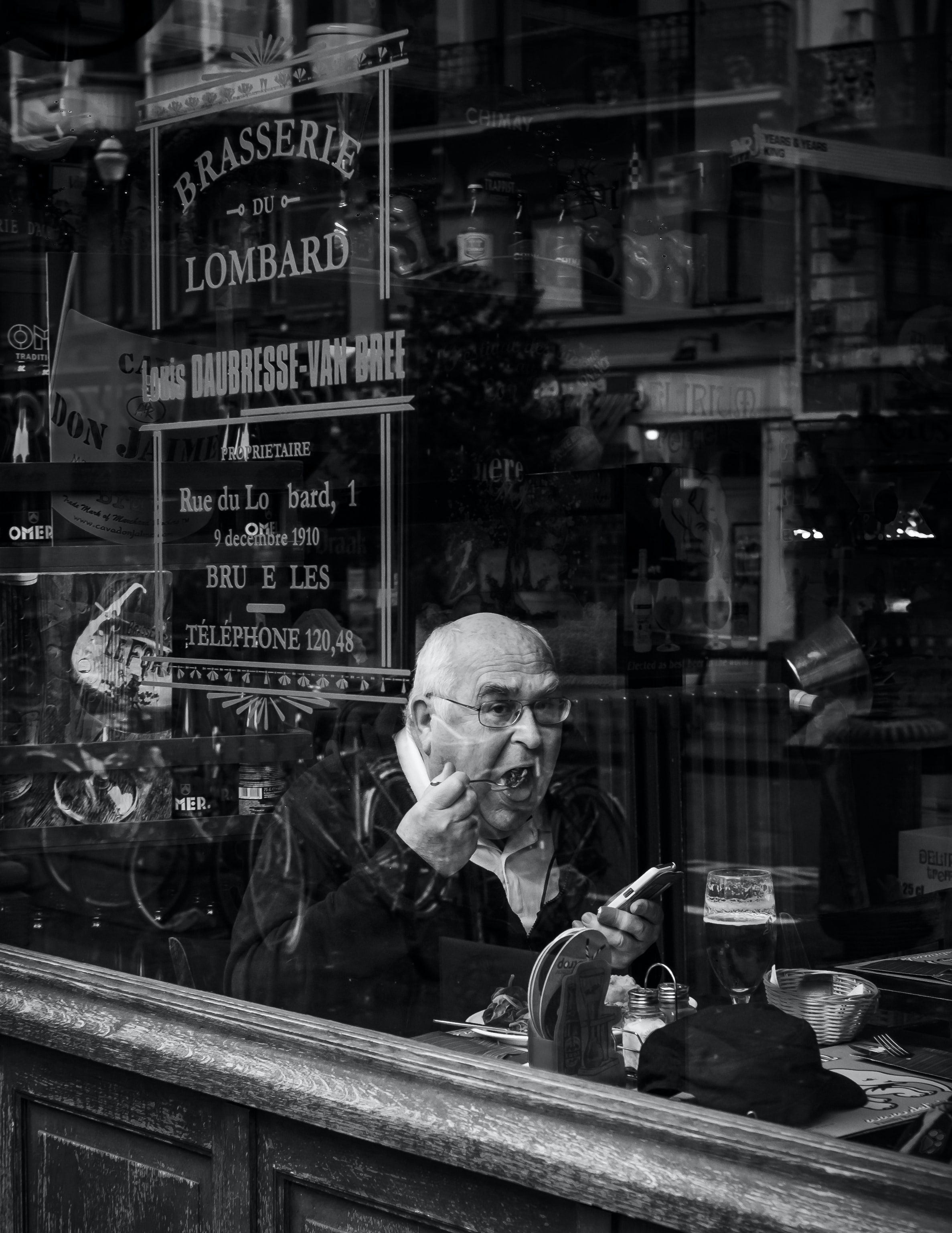 man sitting while eating inside store