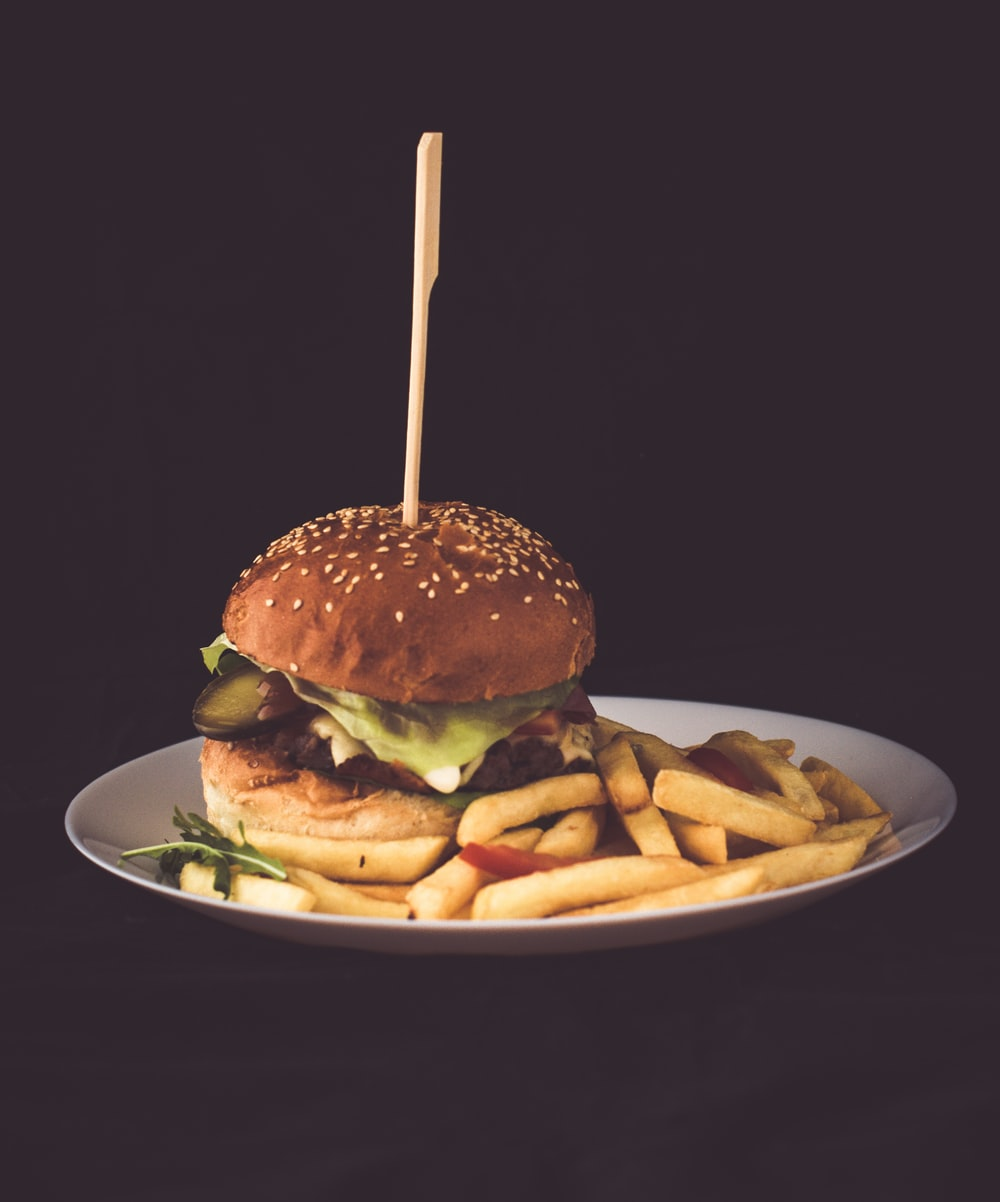fries and hamburger on plate