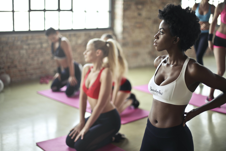 woman wearing sport bra standing on gym floors
