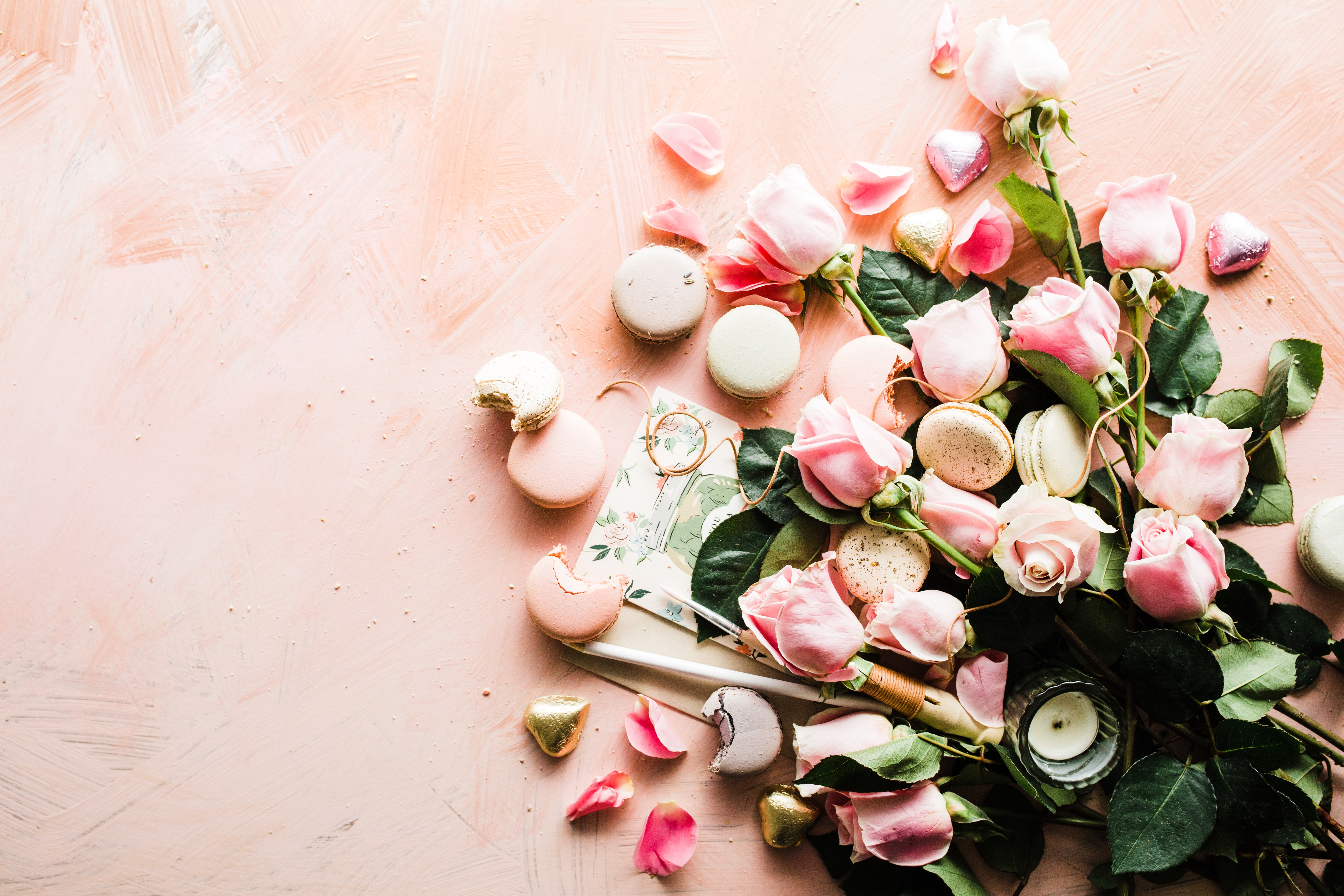 flat-lay photography of macaroons and pink rose flowers