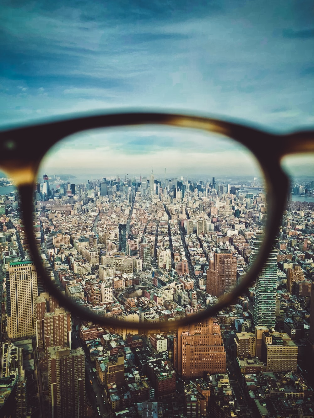 city buildings on eyeglasses view