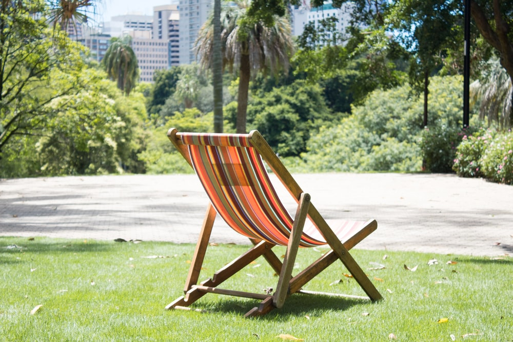orange and brown folding sun chair during daytime