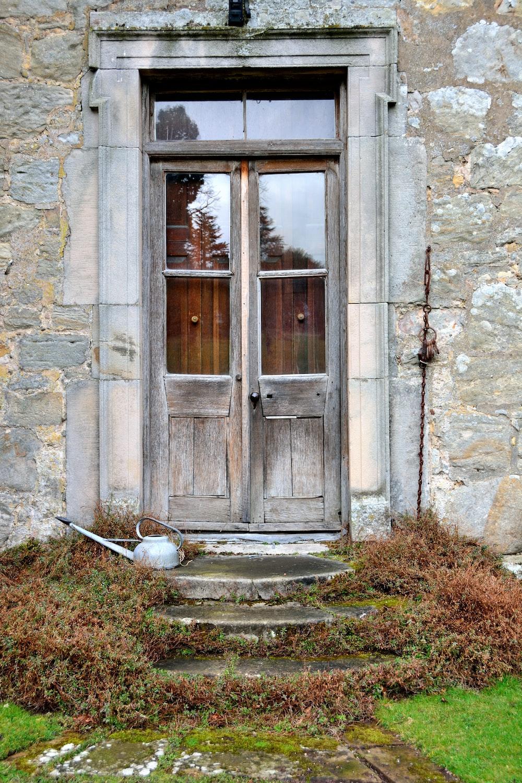 brown wooden door with glass closed