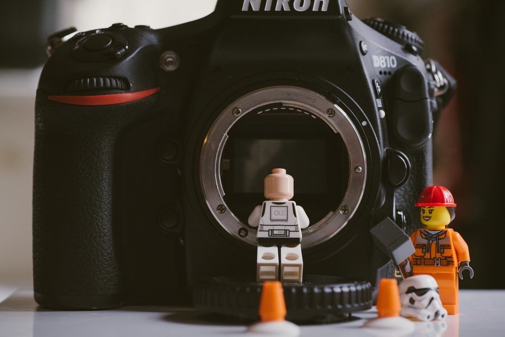 two lego minifigures and nikon D870 camera