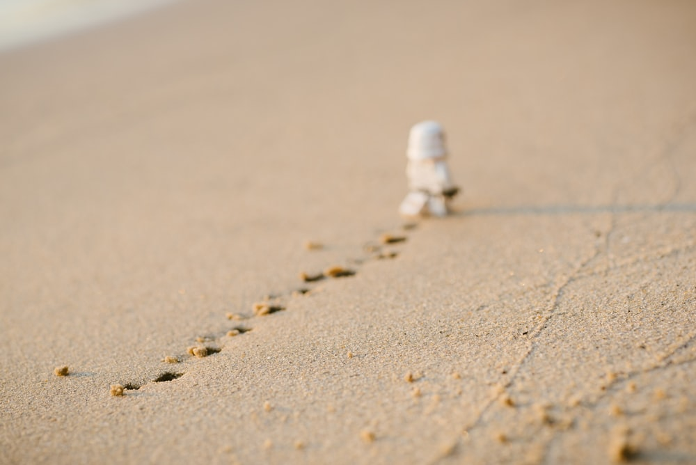 Stormtrooper with footprints on sand