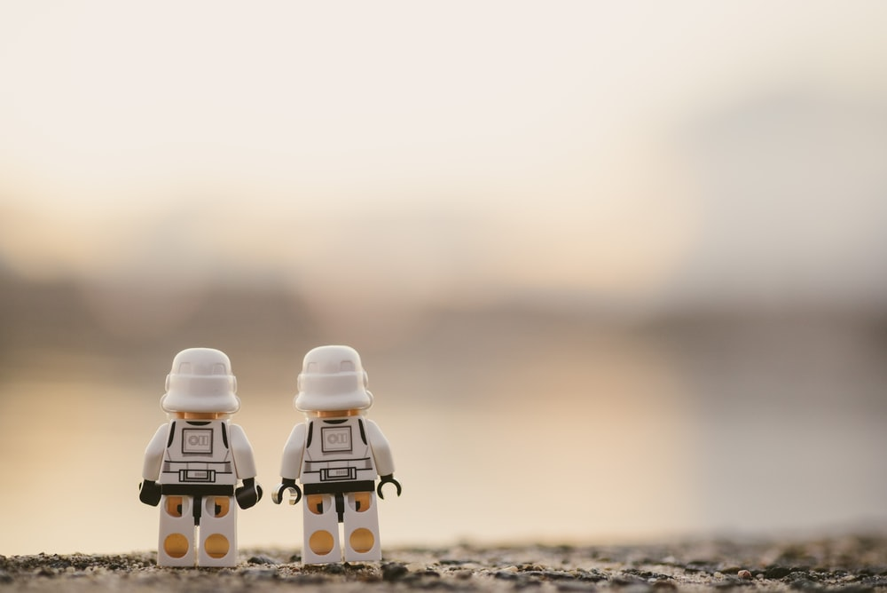 selective focus photography of two white Lego minifigures