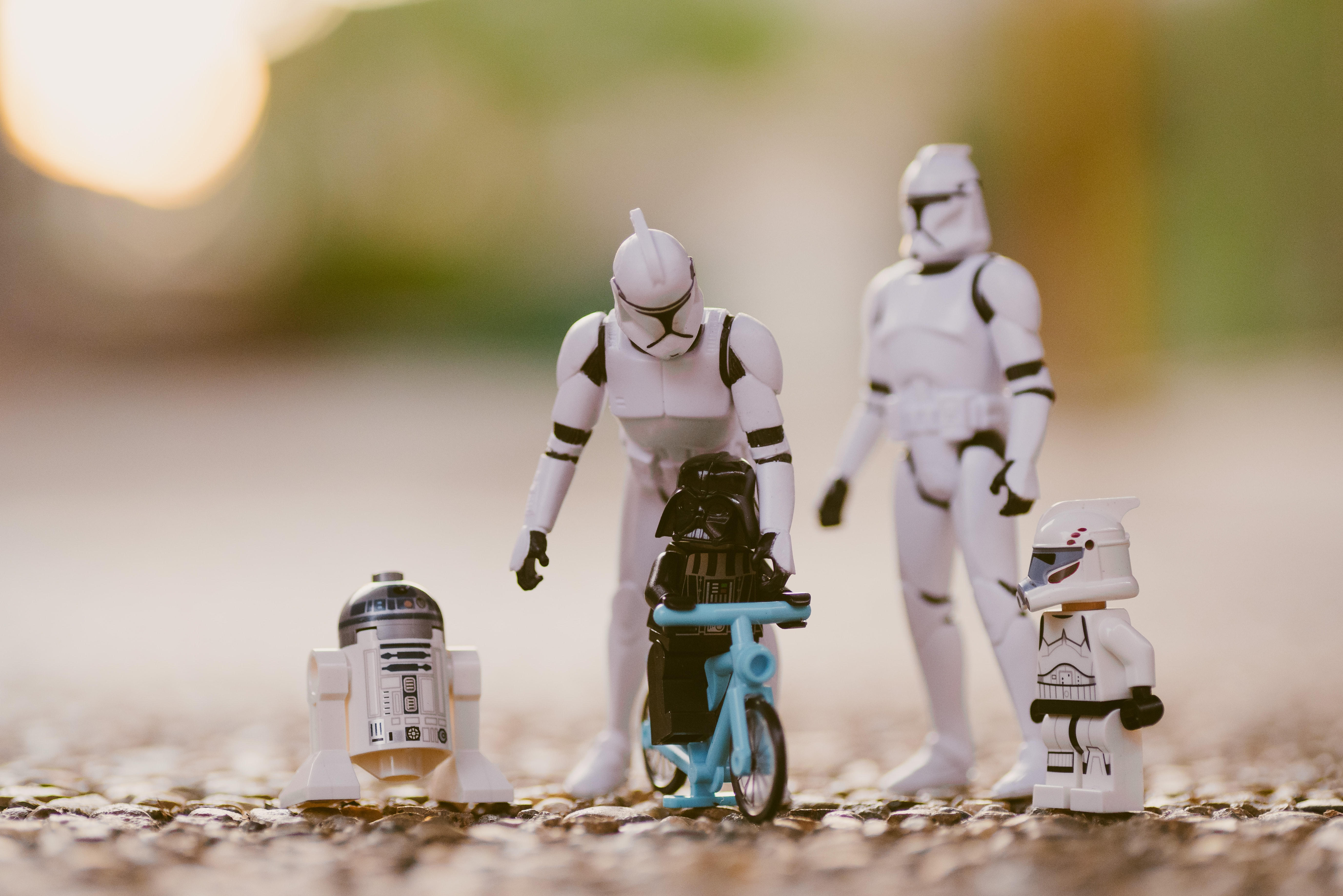 selective focus photography of Star Wars Stormtropper, R2-D2, and Darth Vader toys