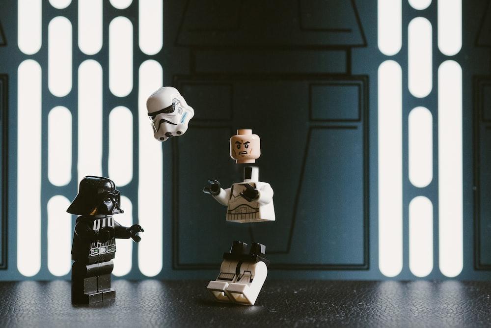 Darth Vader Lego figure beside Stormtrooper