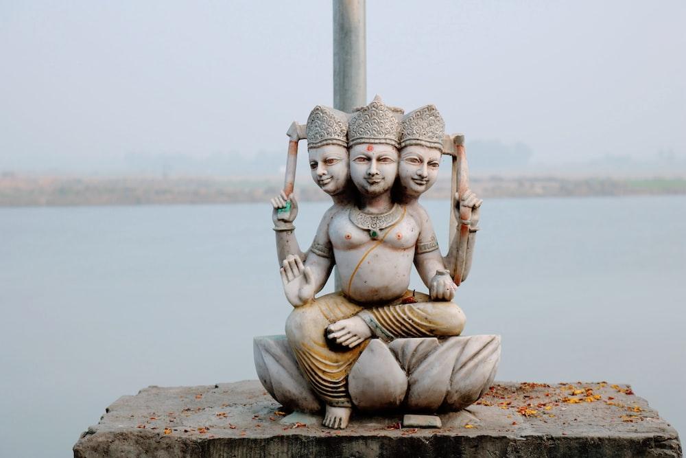 three head buddha statue