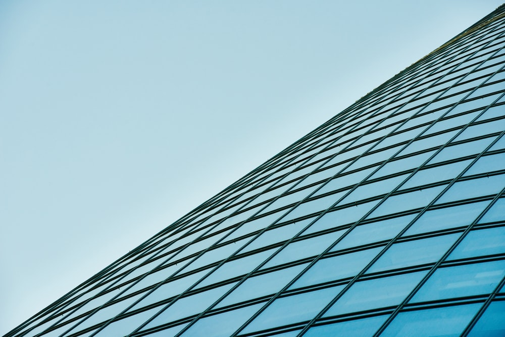 low angle photography of glass building