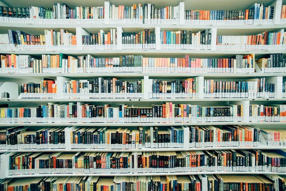 pile of books on shelf