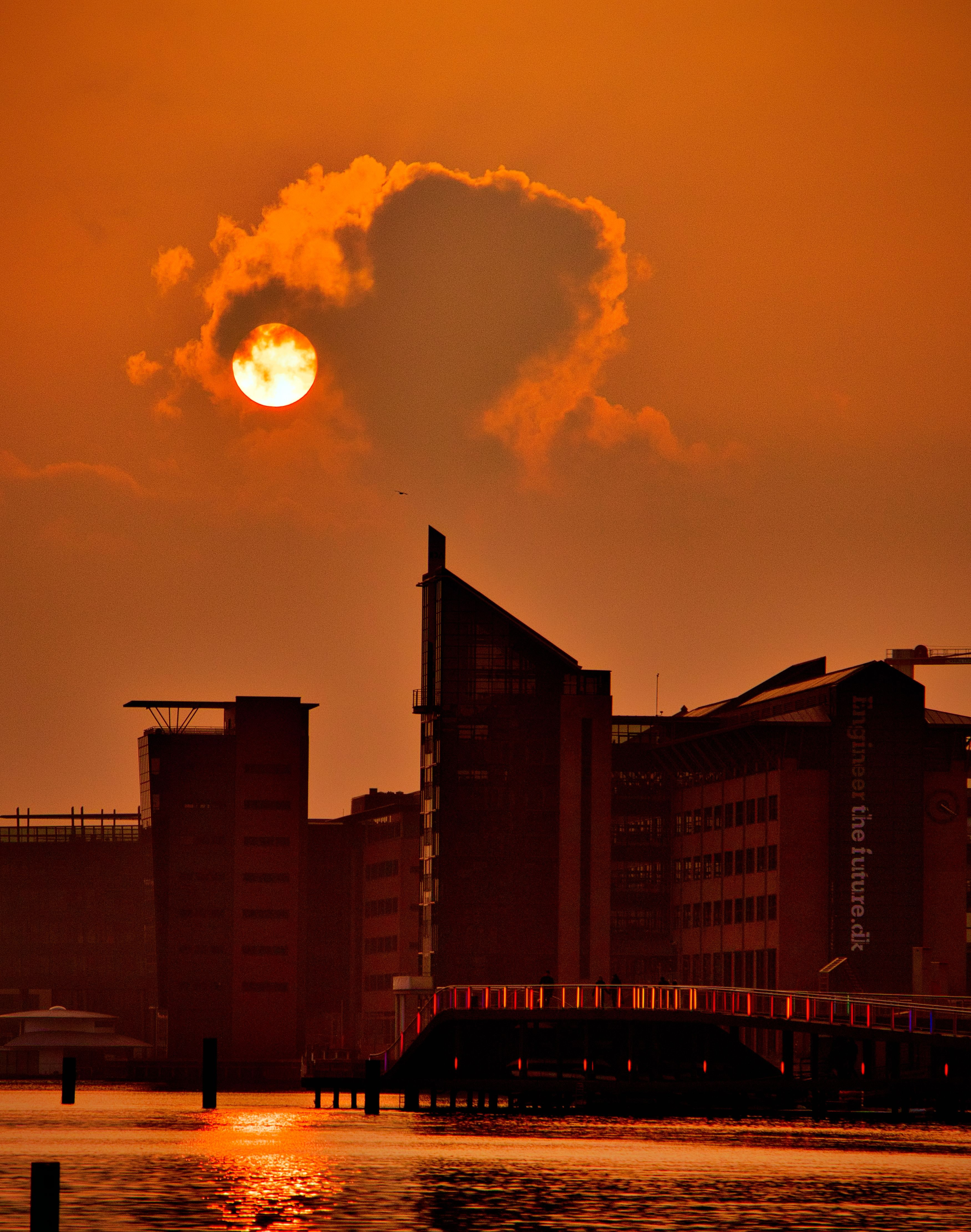 scenery of tall buildings during sunset