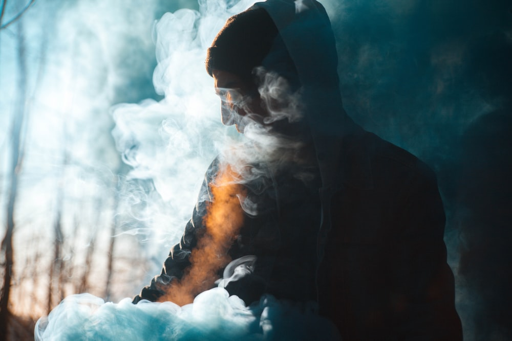 person with smoke silhouette