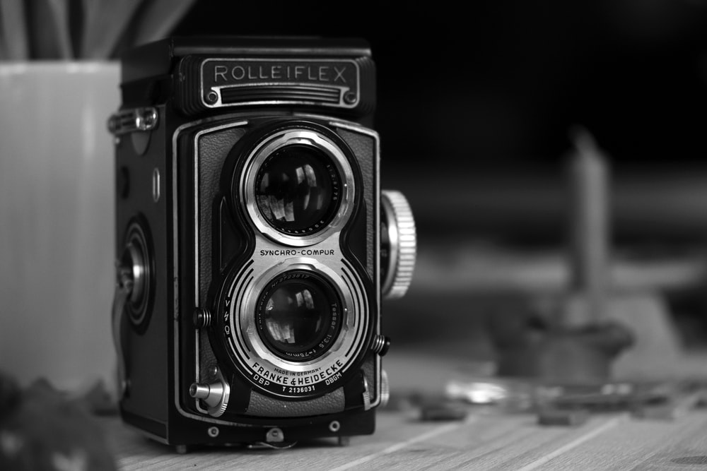 grayscale photography of vintage black camera