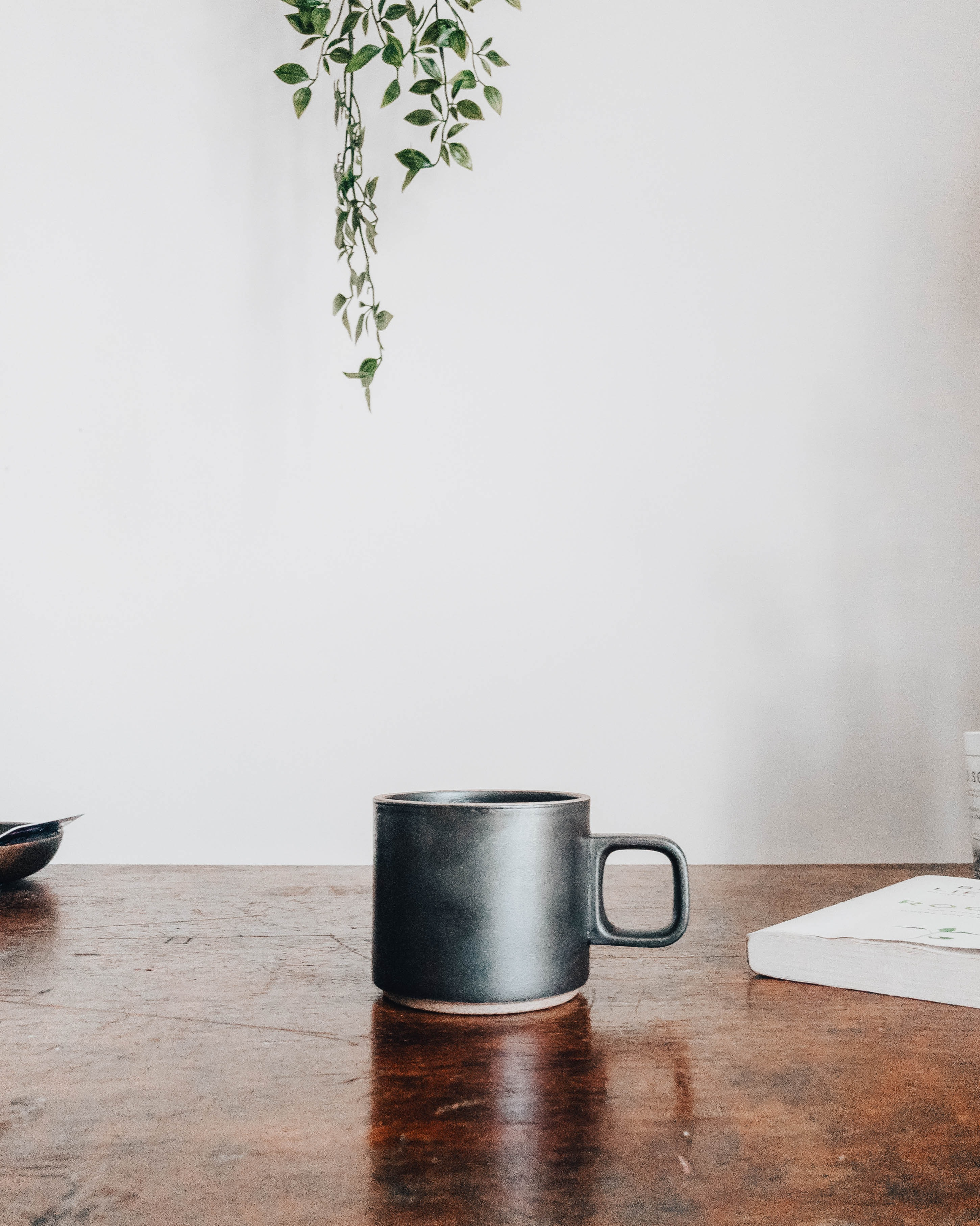 black ceramic mug on brown wooden table