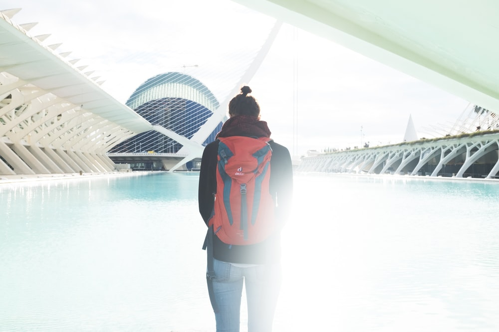 man with red backpack