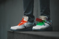 person wearing white-green-and-orange sneakers