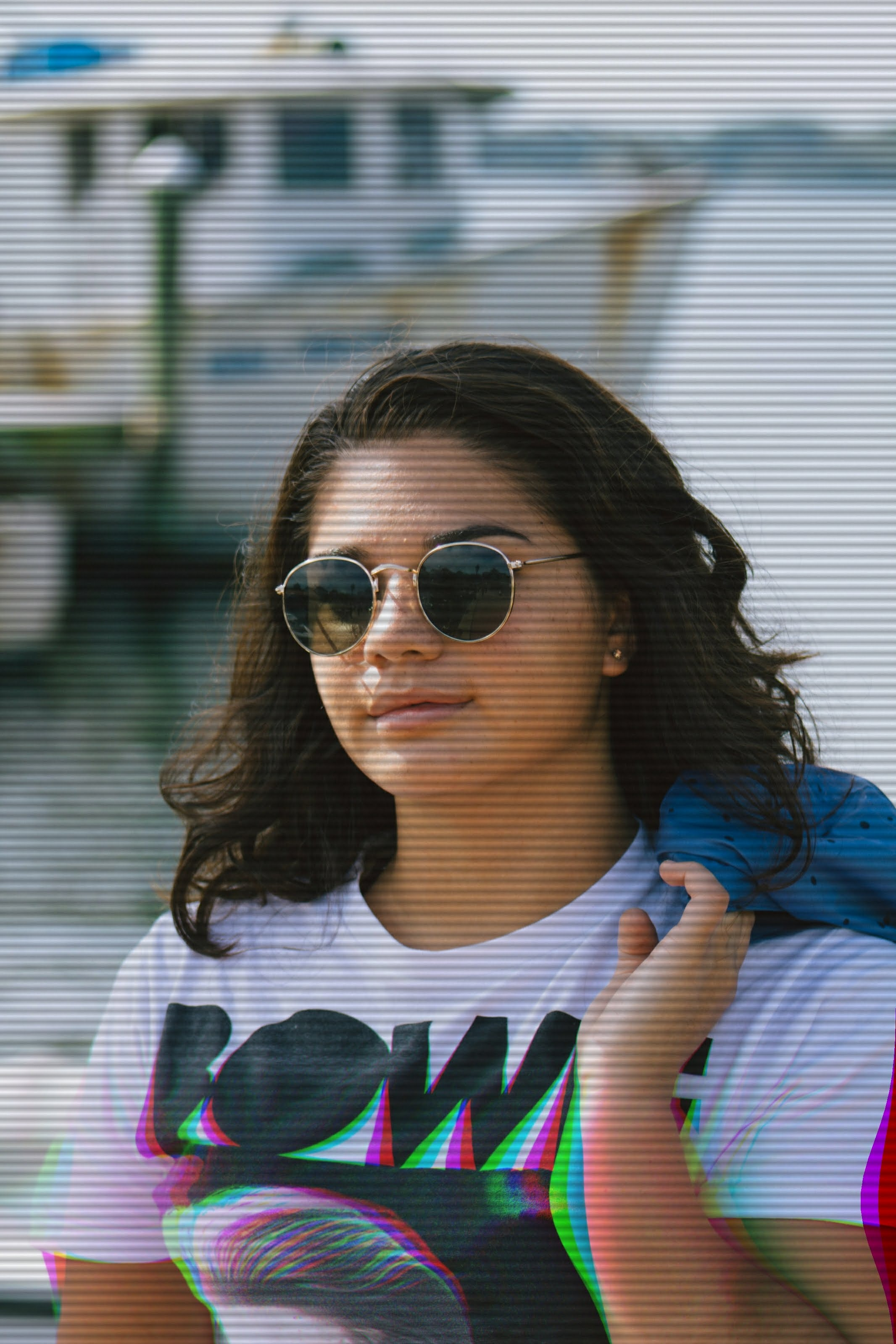 woman wearing sunglasses holding blue textile