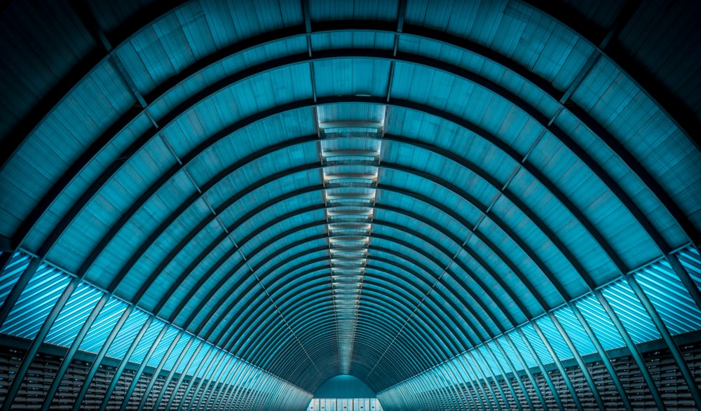 well lighted empty tunnel