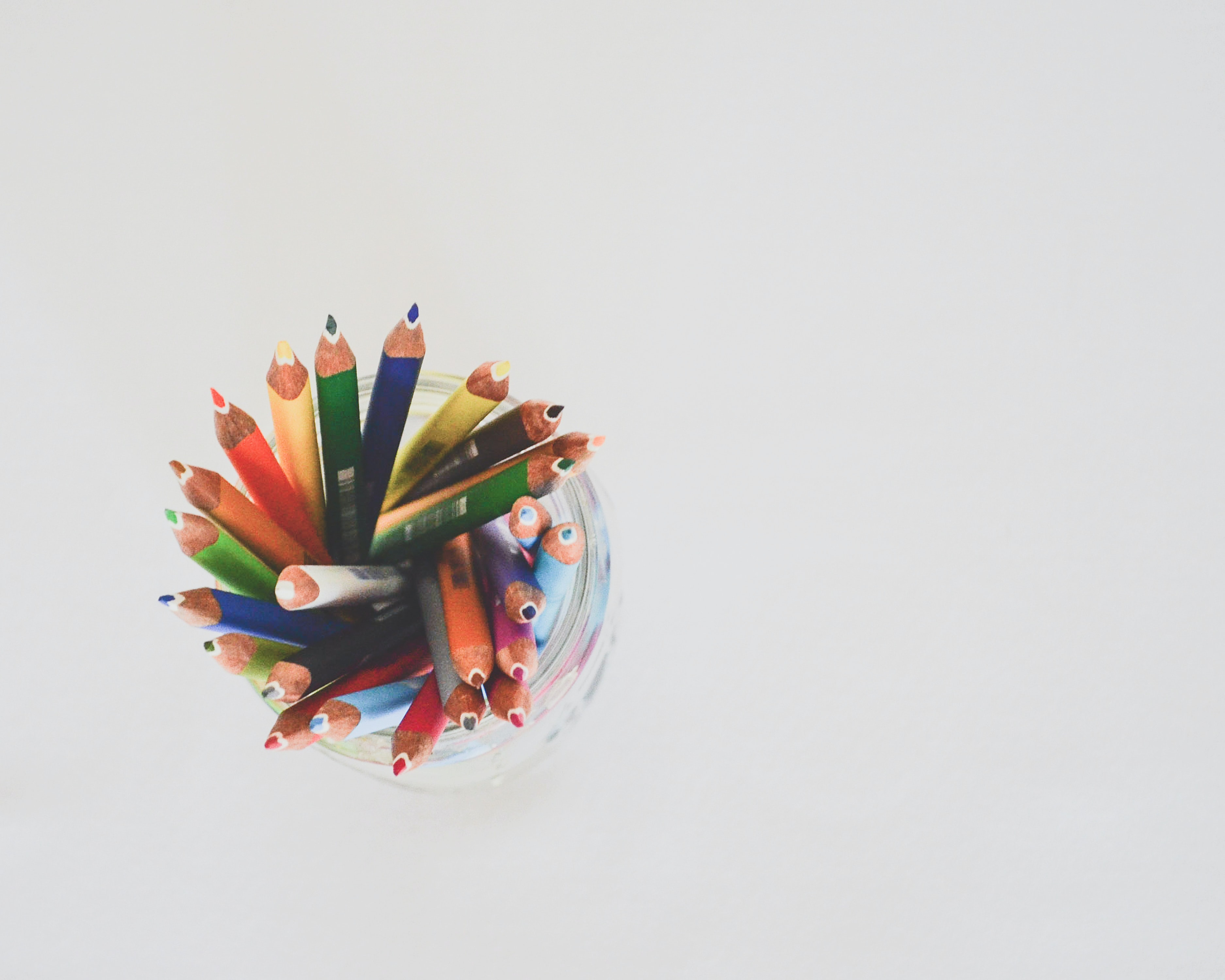 colored pencils in top view photography