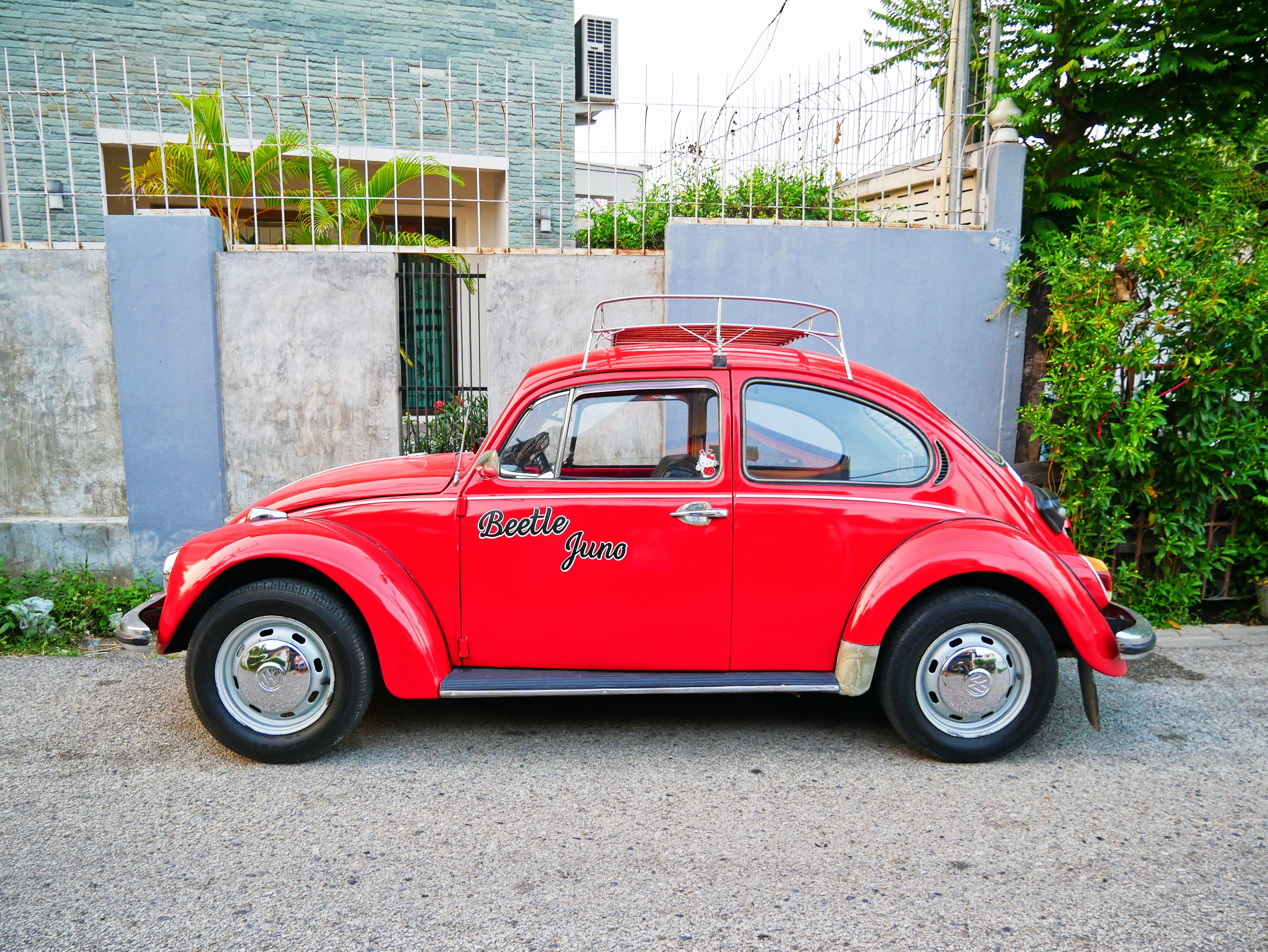 red beetle parking in front of house