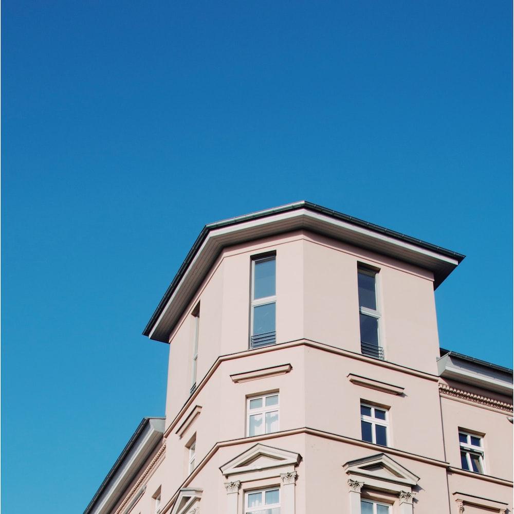 low angel photo of beige building