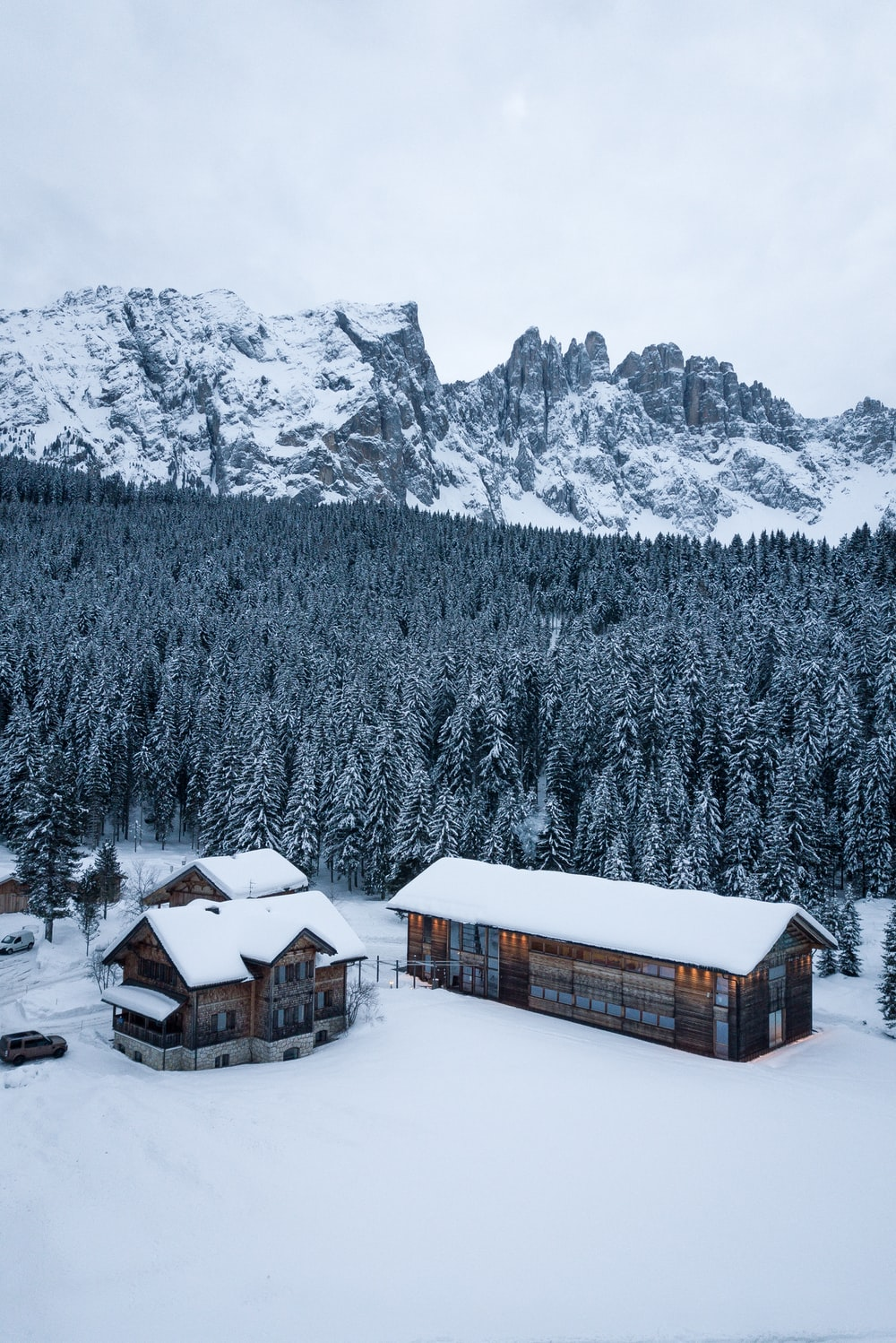 brown wooden houses on snow