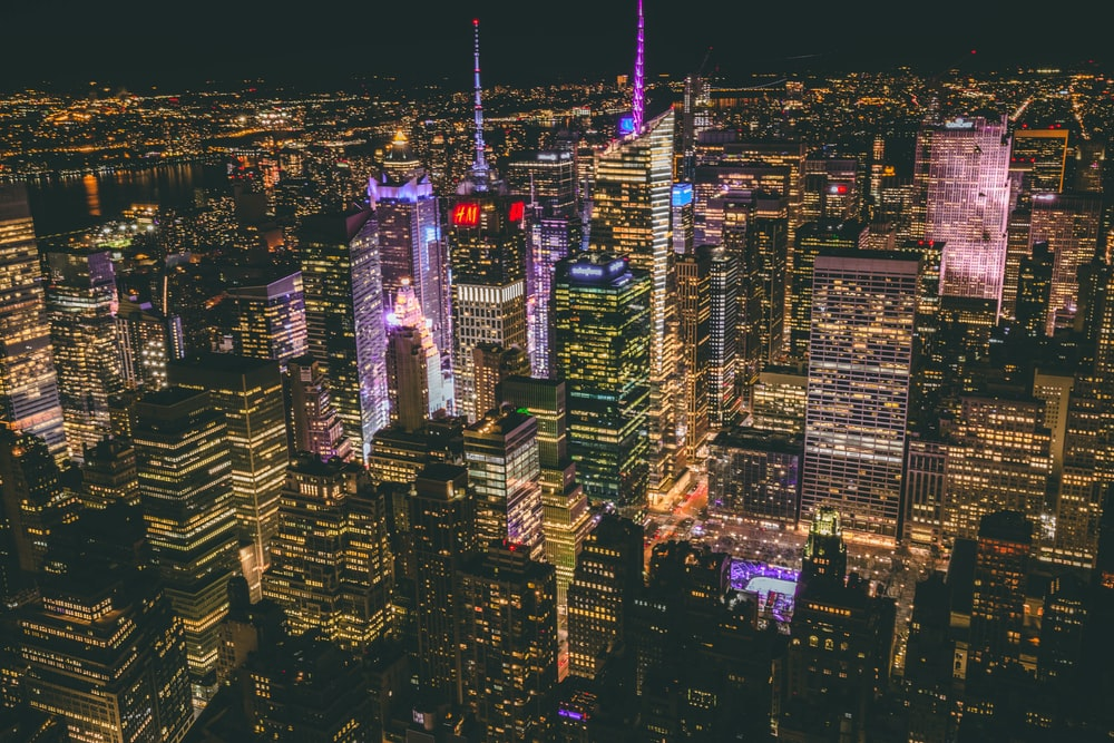 aerial photography of city buildings during nighttime