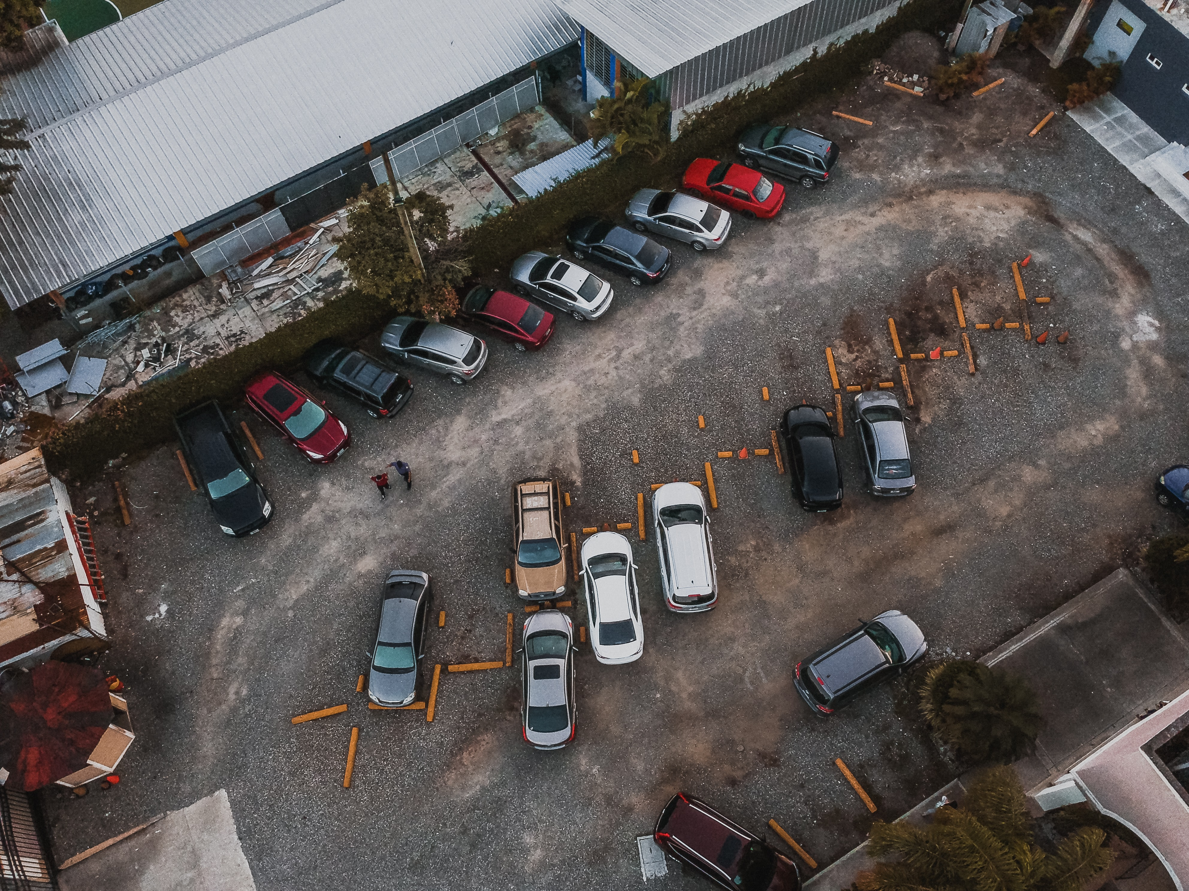 aerial photography of assorted vehicles parked beside building at daytime