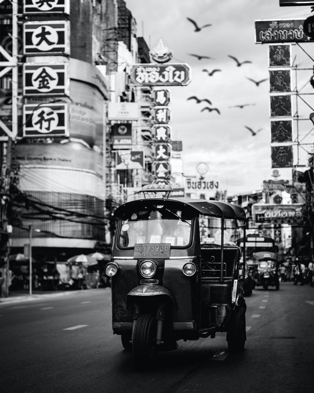 gray auto rickshaw on road
