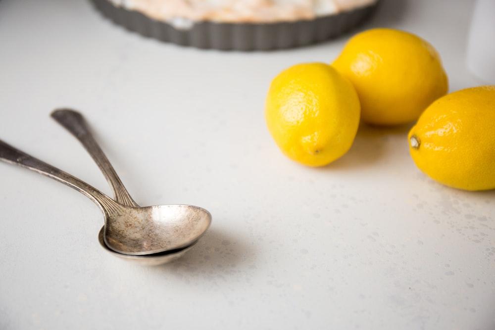 gold spoon near lemon