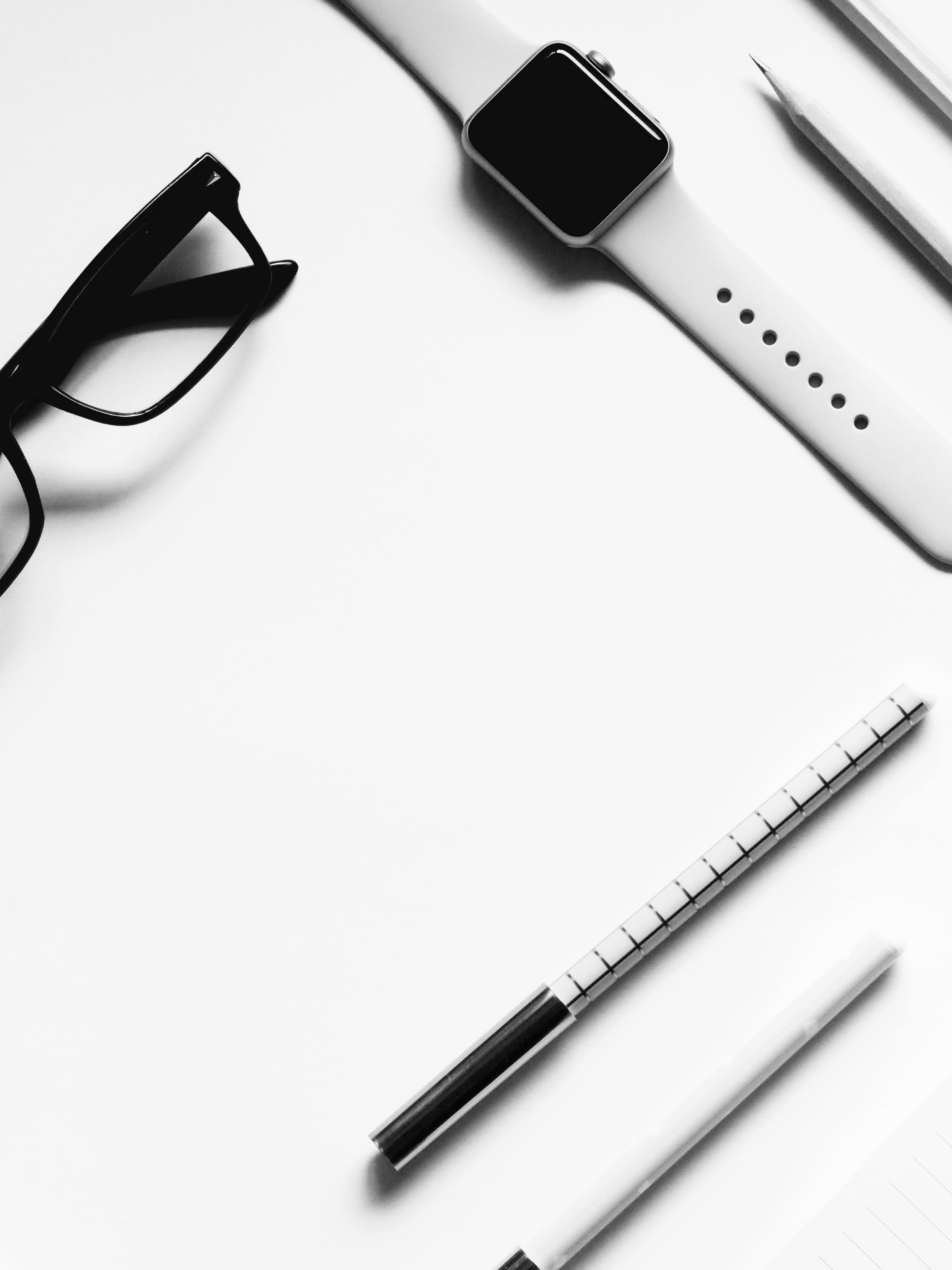eyeglasses on white surface
