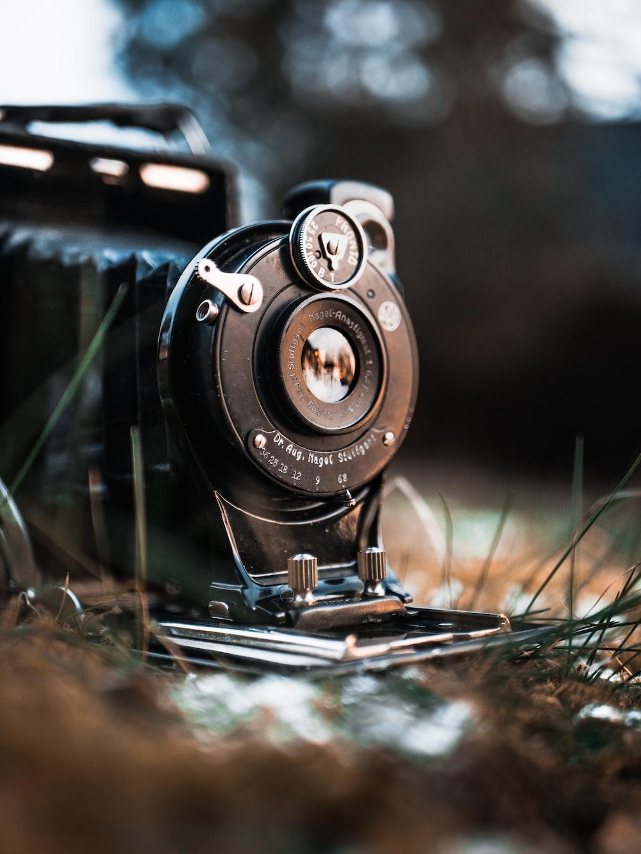 black land camera on grass land