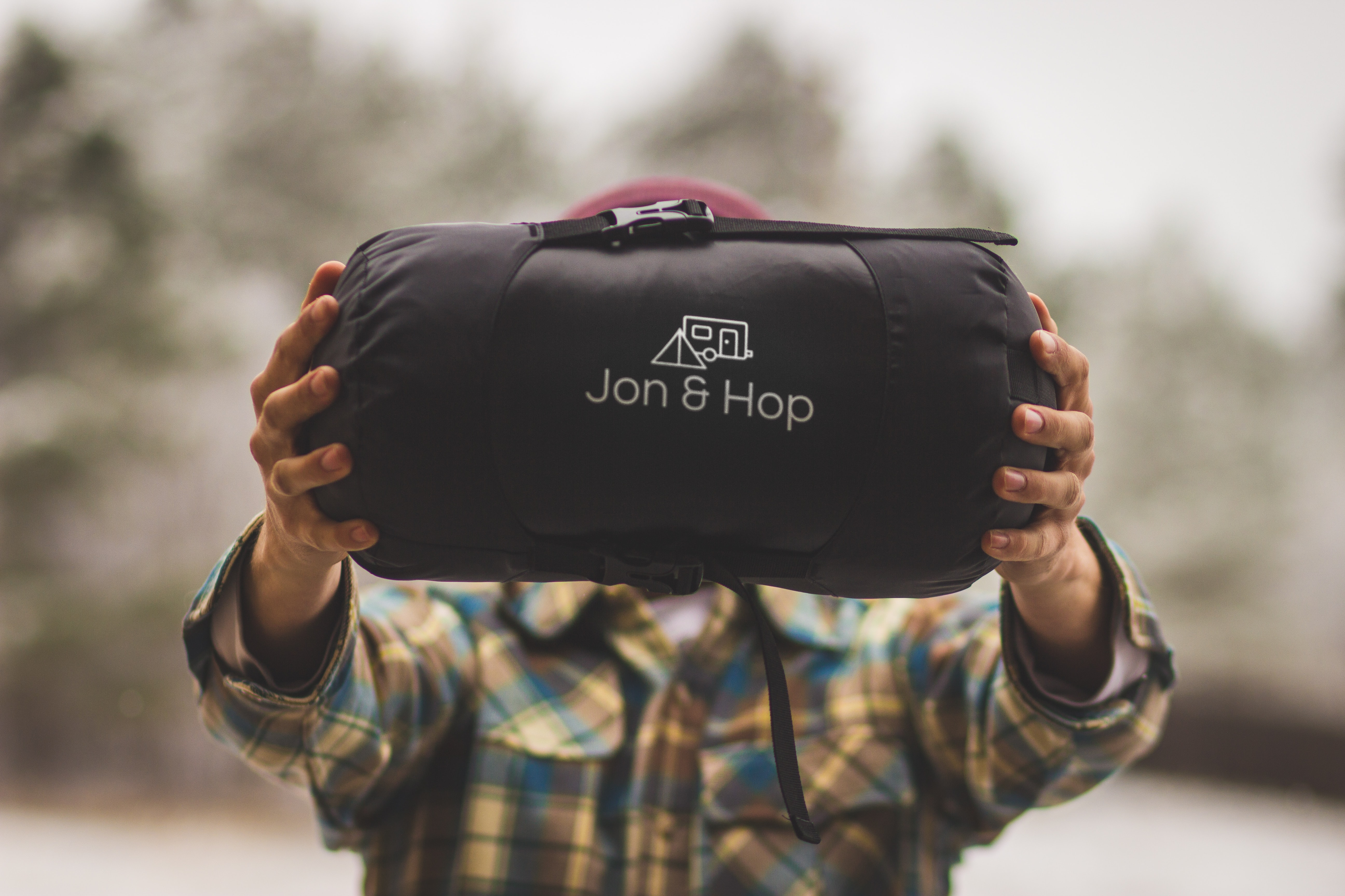 person holding Jon & Hop bag
