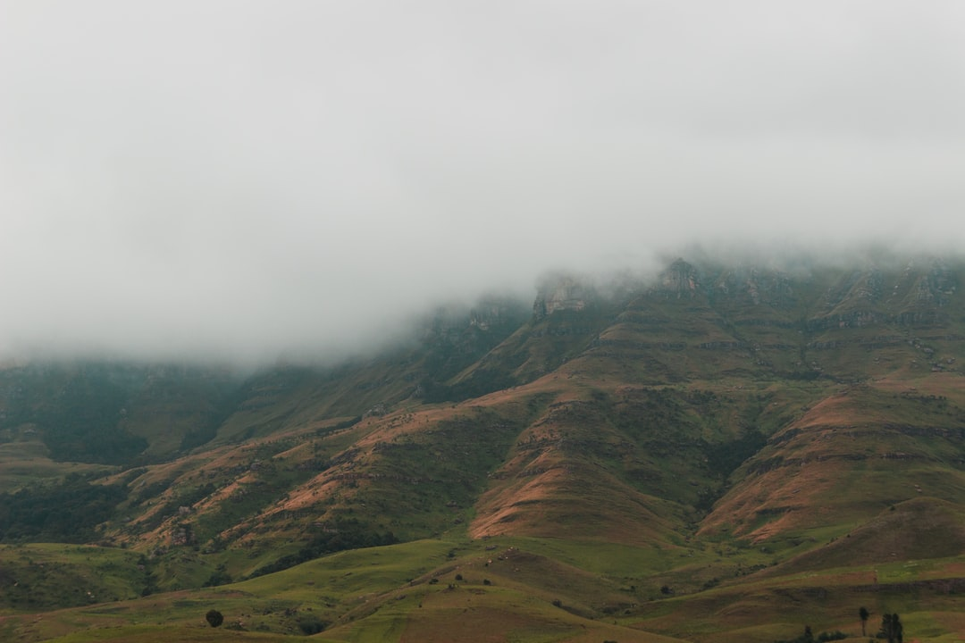 A group of friends and I spent a few days in a remote cabin in the Drakensberg Mountain Range in South Africa. While playing cards I saw an opportunity for this shot as the fog started to settle in on our valley.