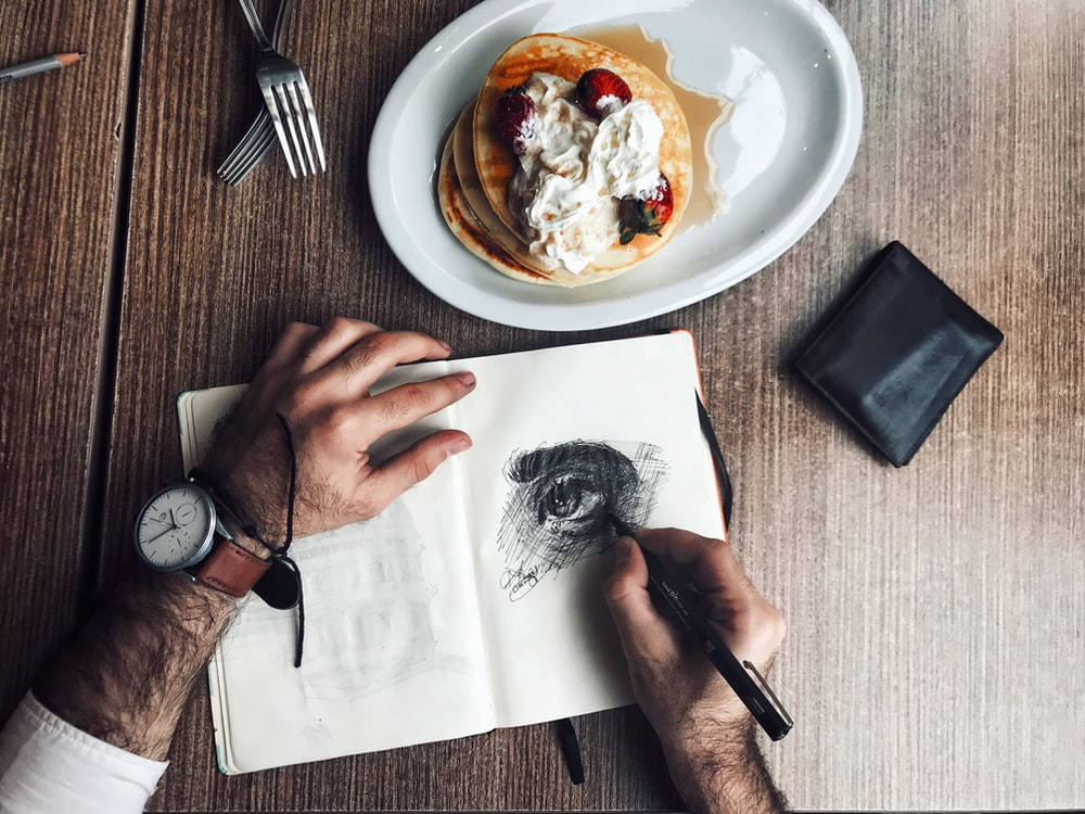 person about to drawing human eye