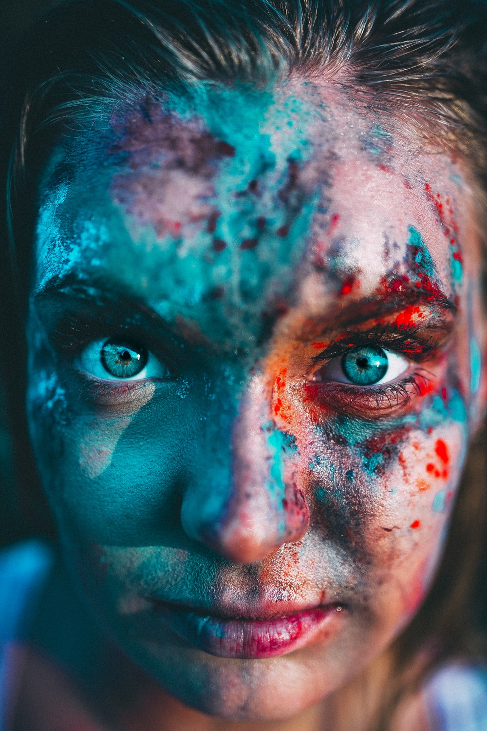 portrait photography of woman with face paint