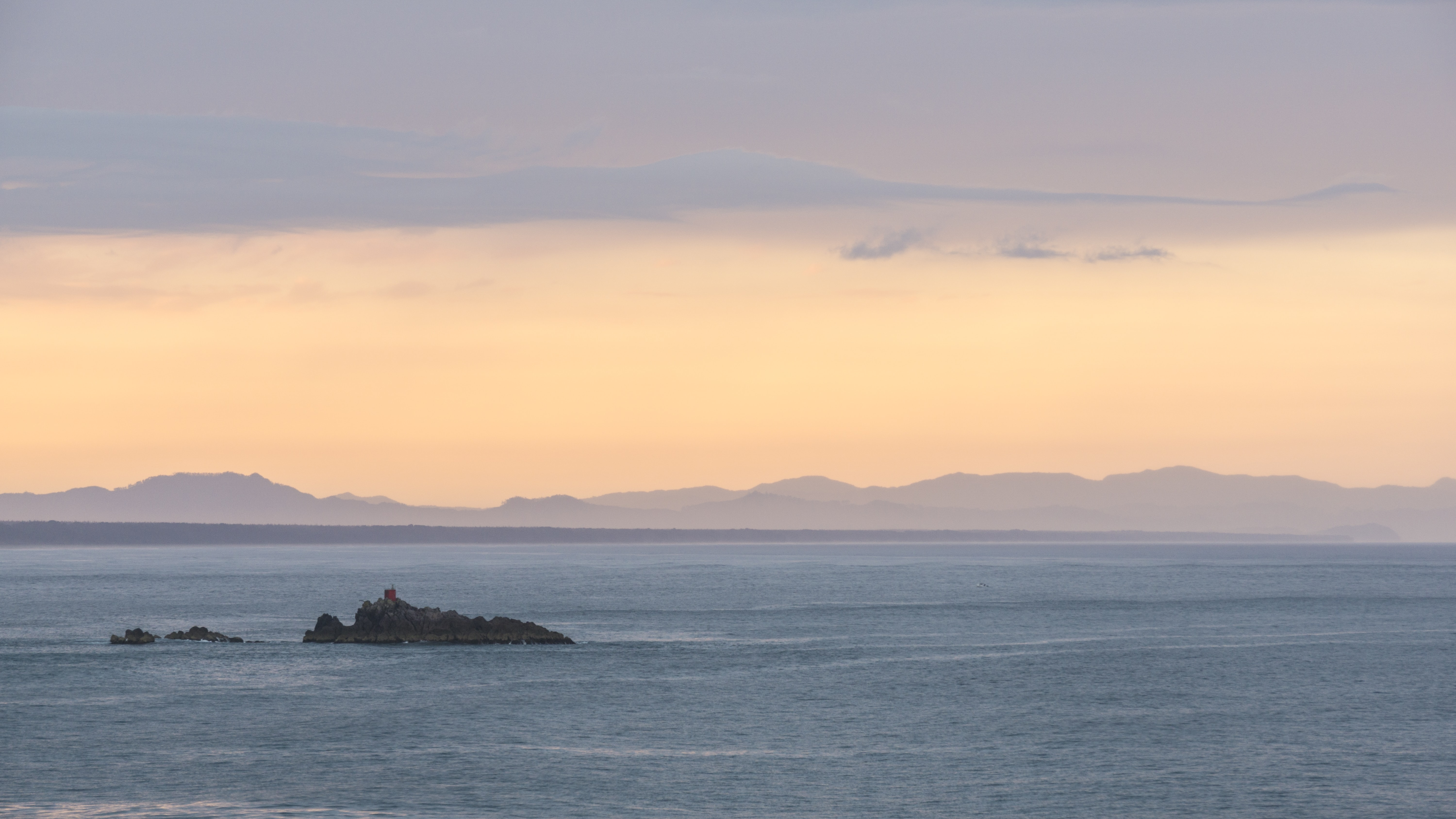 islet on sea during daytime
