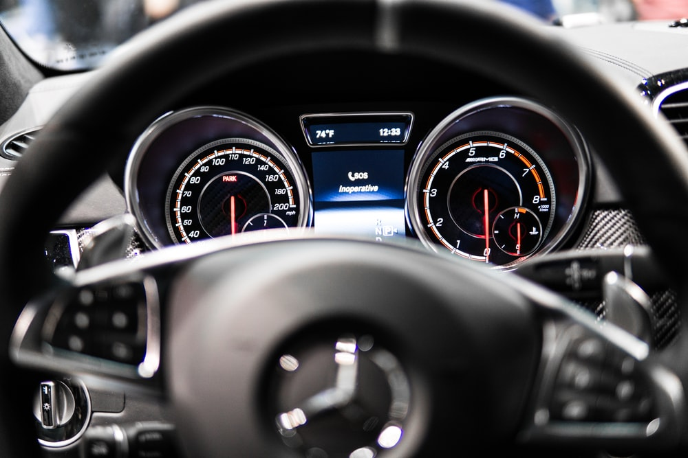 black Mercedes-Benz steering wheel