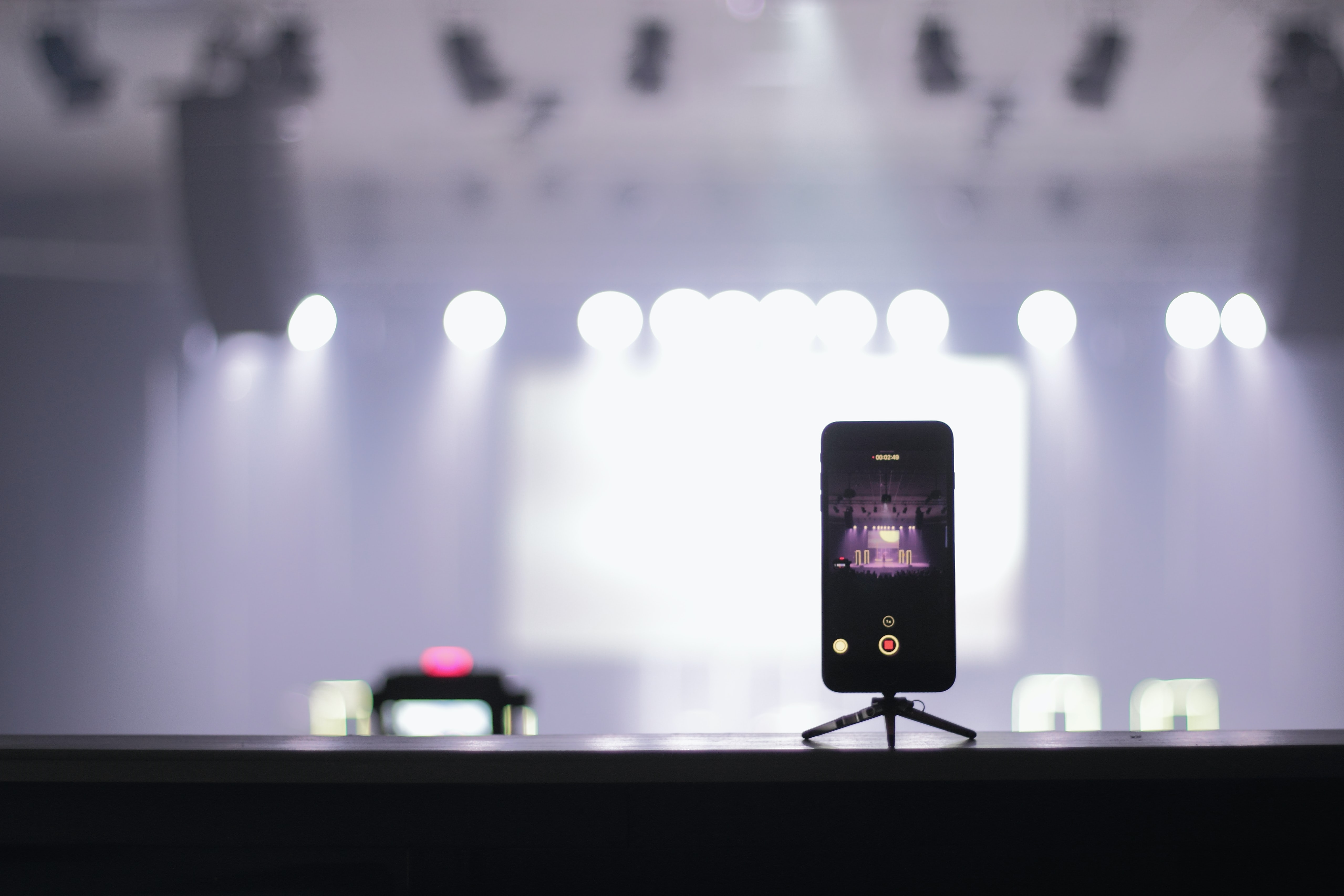 selective focus photography of iPhone displaying theater
