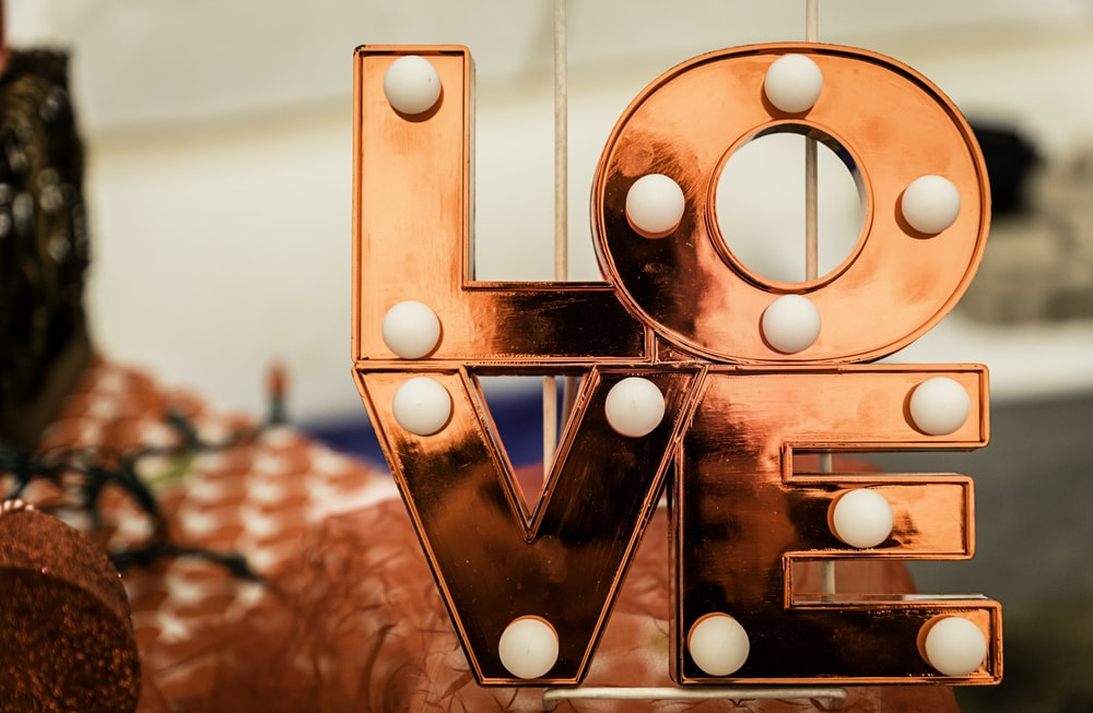 brown and white love lighted signage