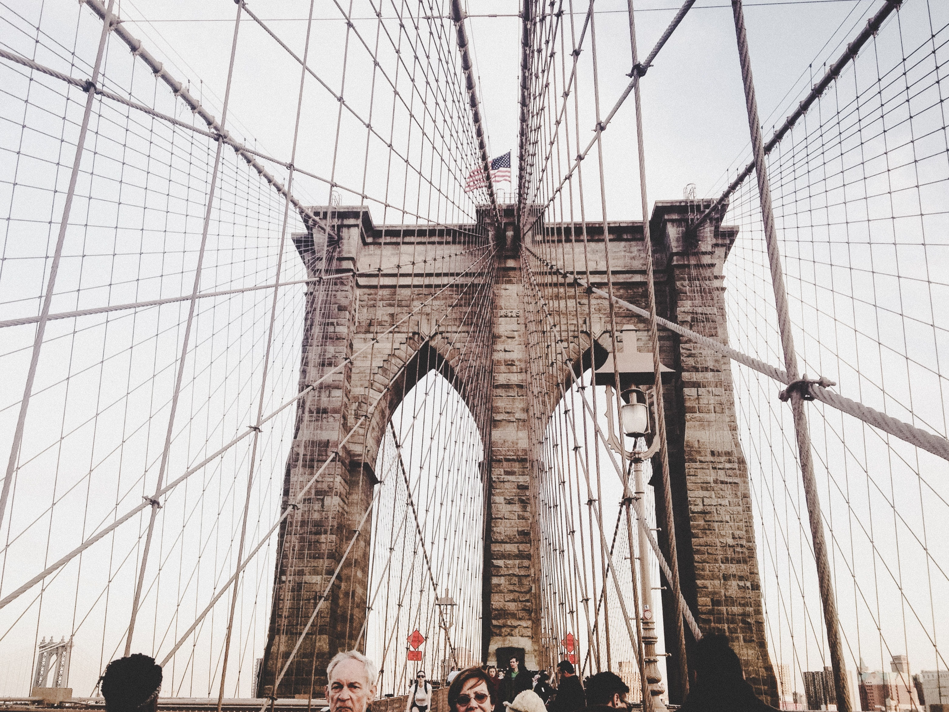 people walking on Brooklyn Bridge, New York