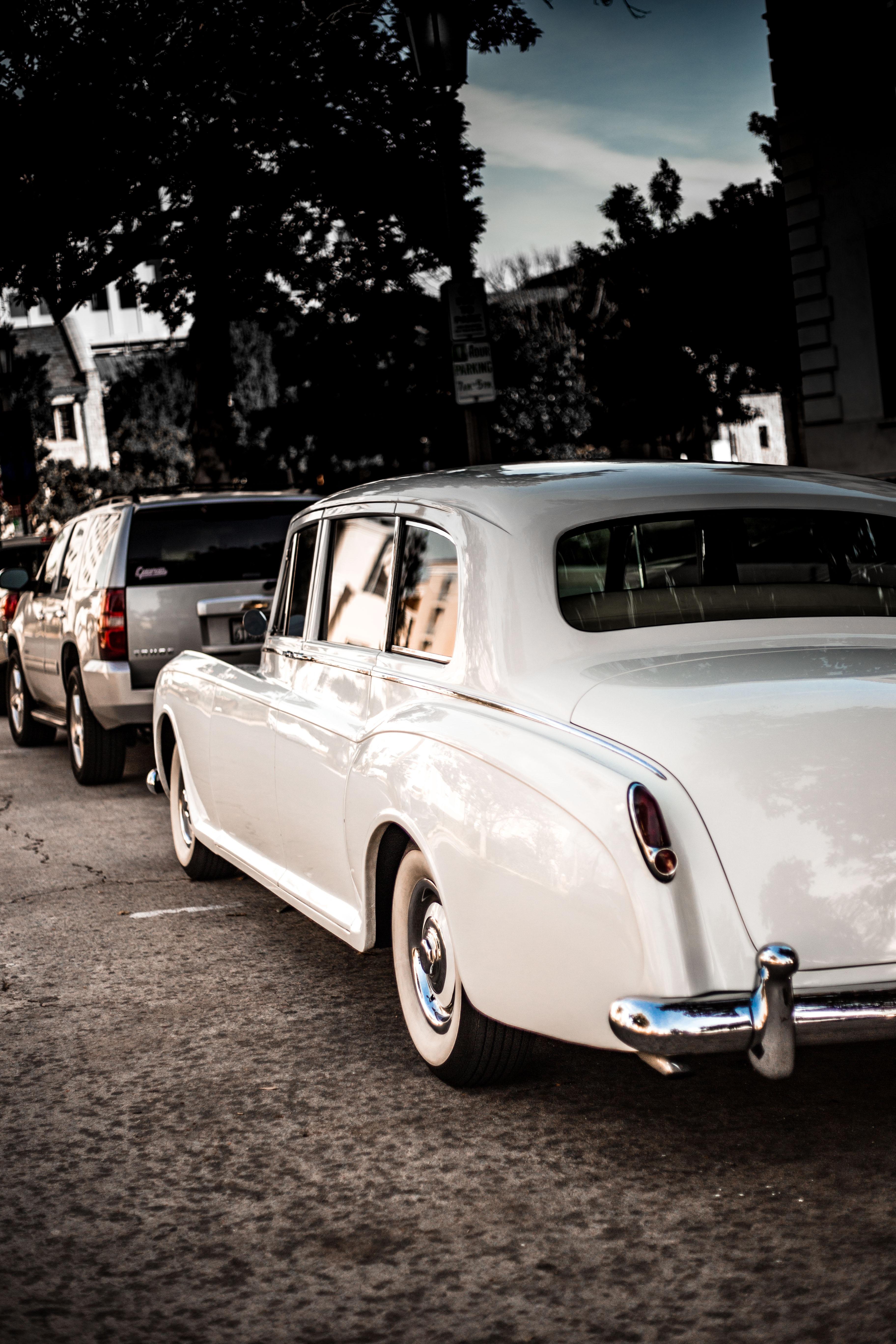 photo of white classic sedan