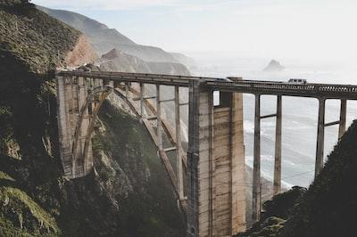 cars on concrete bridge during day californium zoom background
