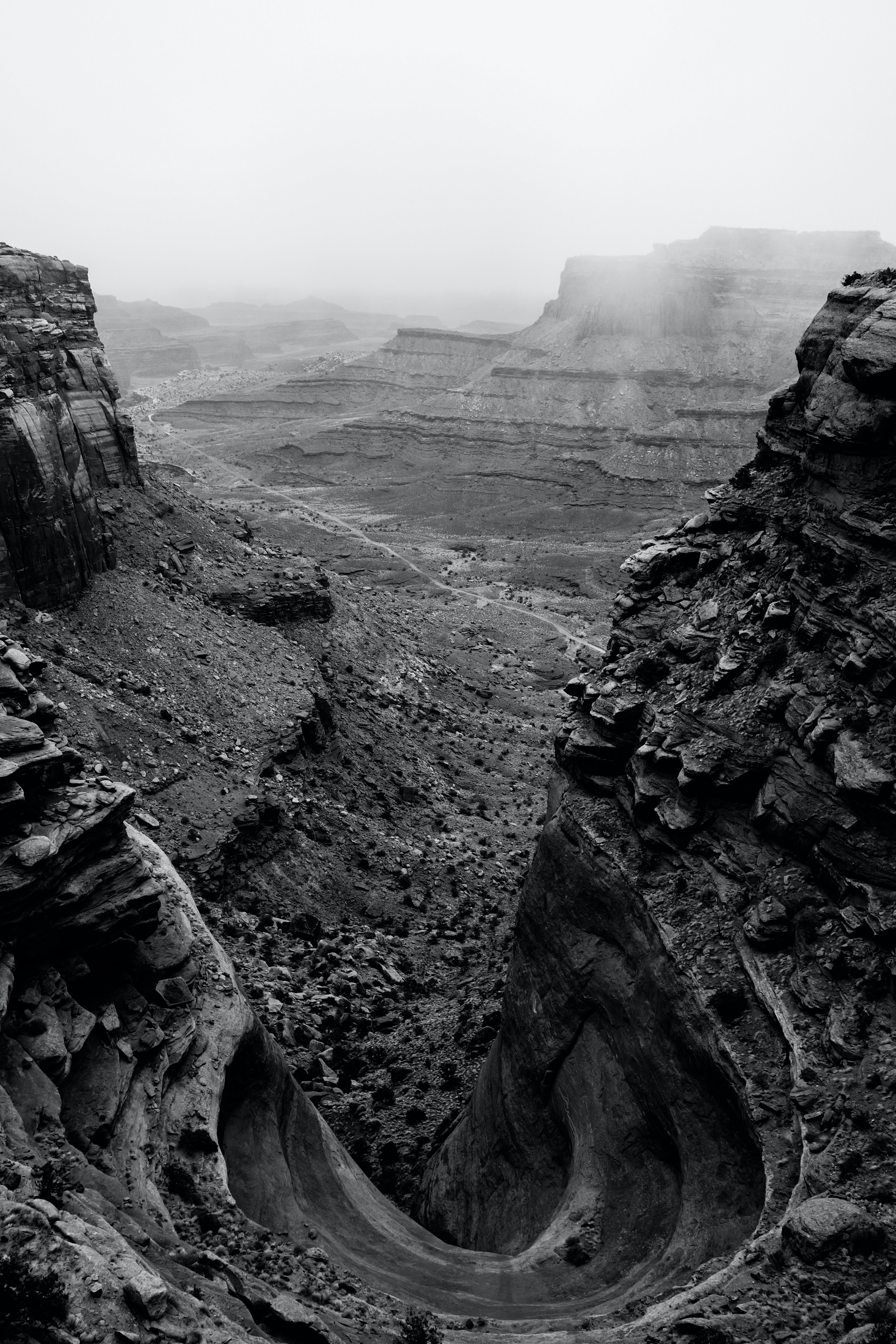grayscale photography of rock mountain