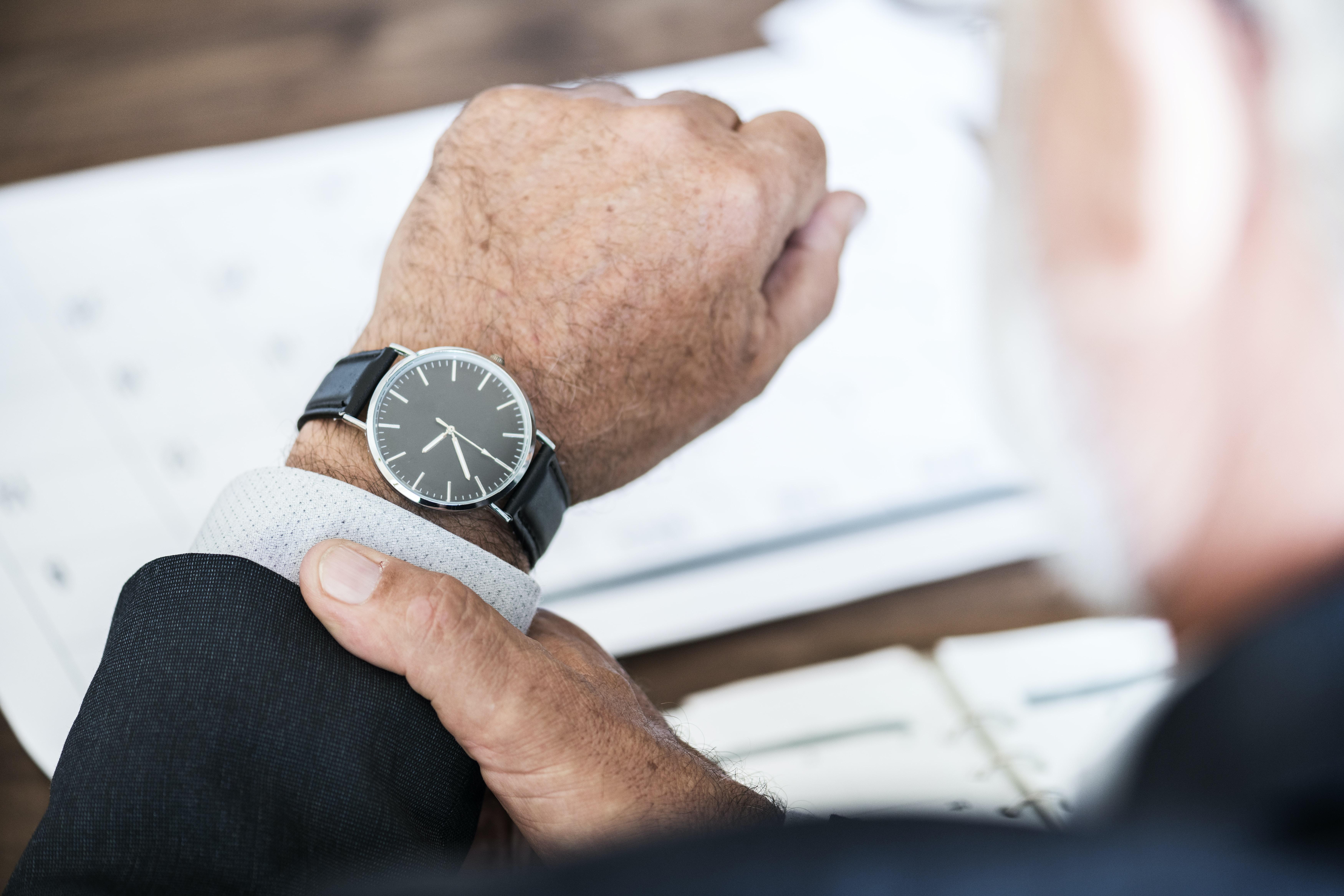 man wearing round watch at 9:36